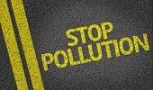Stop Pollution written on the road