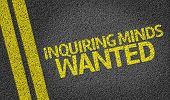Inquiring Minds Wanted written on the road