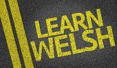 Learn Welsh written on the road