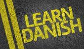Learn Danish written on the road