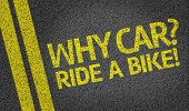 Why Car? Ride a Bike! written on the road