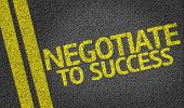 Negotiate to Success written on the road