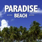 Paradise Beach written on a beautiful beach background