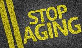 Stop Aging written on the road