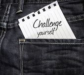 Challenge Yourself written on a peace of paper on a jeans background