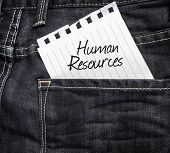 Human Resources written on a peace of paper on a jeans background