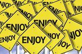 Enjoy written on multiple road sign