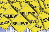 Believe written on multiple road sign