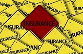 Insurance written on multiple road sign