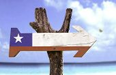 Chile wooden sign with a beach on background