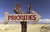 Priorities wooden sign on desert background