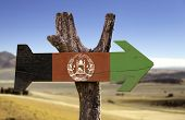 Afghanistan wooden sign with a desert background