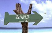 Saudi Arabia wooden sign with a river on background