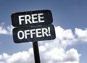 Free Offer sign with clouds and sky background
