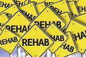 Rehab written on multiple road sign