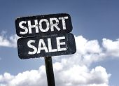 Short Sale sign with clouds and sky