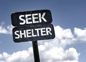 Seek Shelter sign with clouds and sky background