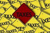 Taxes written on multiple road sign