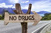 No Drugs wooden sign with a street background