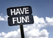 Have Fun! sign with clouds and sky background