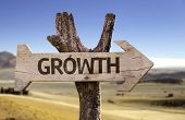 Growth wooden sign with a desert background
