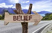Belief wooden sign with a street background