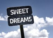 stock photo of sweet dreams  - Sweet Dreams sign with clouds and sky background  - JPG