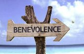 Benevolence wooden sign with a beach on background