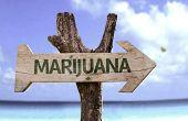 pic of rastafari  - Marijuana wooden sign with a beach on background  - JPG