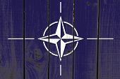 Nato flag on wooden background