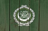 Arab League flag on wooden background