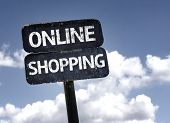 Online Shopping sign with clouds and sky background
