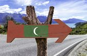 Maldives wooden sign with a landscape background