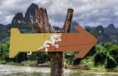 Bhutan wooden sign with rural background