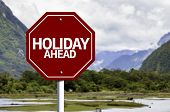 Holiday Ahead red sign with a landscape background