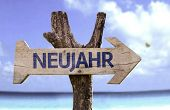 "stock photo of reveillon  - ""Neujahr"" (In German: New Year) sign with a beach on background - JPG"