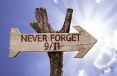 Never Forget 9/11 wooden sign with sky background