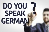 Business man pointing to transparent board with text: Do you Speak German?