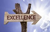 Excellence wooden sign on a beautiful day