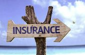 picture of nuclear family  - Insurance wooden sign with a beach on background - JPG