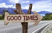 Good Times wooden sign with a road background