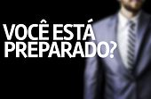 Business man with black board with text: Are you Ready? (In portuguese)
