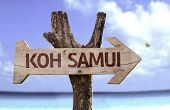 Koh Samui wooden sign with a beach on background