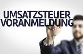 Business man pointing to transparent board with text: Umsatzsteuer Voranmeldung (German Tax)
