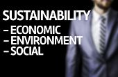 Sustainability Descriptions  written on a board with a business man on background