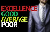 Excellence Good Average Poor written on a board with a business man on background