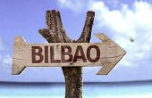 Bilbao wooden sign with a beach on background