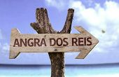 Angra dos Reis wooden sign with a beach on background