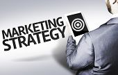 Business man with the text Marketing Strategy in a concept image