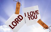 Lord I Love You on Paper Note on sky background
